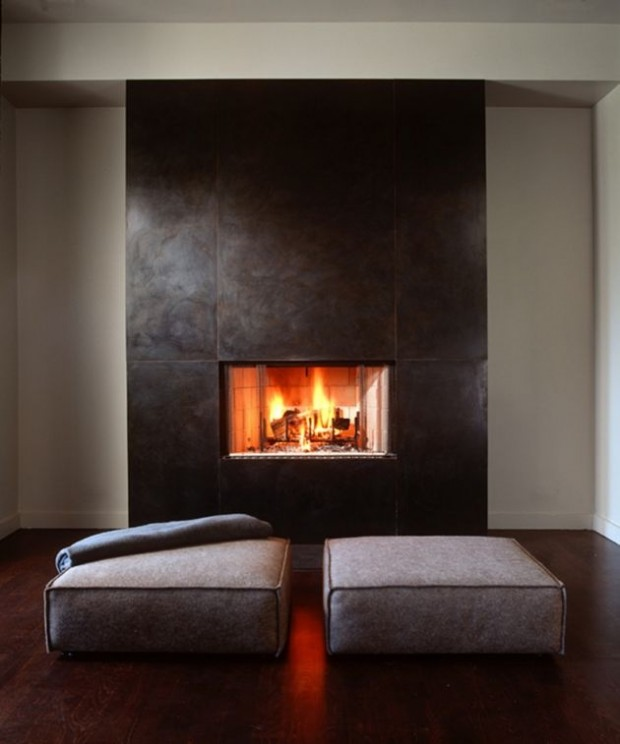 fireplace accent wall with cushions