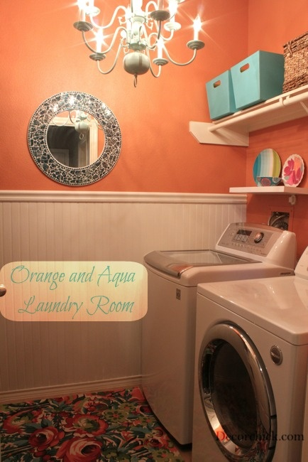 orange and aqua laundry room